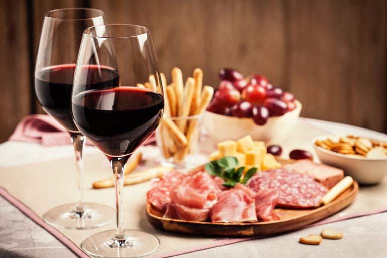 red wine and food plater